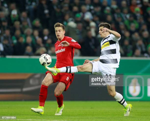 Jonas Hofman of Borussia Monchengladbach in action against Bastian Oczipka of Eintracht Frankfurt during the DFB Cup semifinal soccer match between...