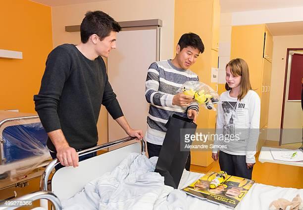 Jonas Hofmann and JooHo Park is seen during the annual visit of Borussia Dortmund at the children's hospital on November 30 2015 in Dortmund Germany