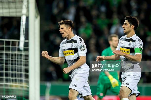 Jonas Hofmann and Lars Stindl of Borussia Moenchengladbach celebrate their team's first goal during the DFB Cup Semi Final between Borussia...