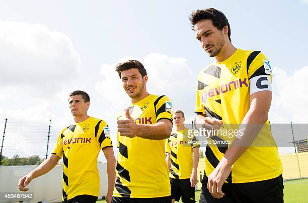 Jonas Hofmann Milos Jojic and Mats Hummels on their way to the Borussia Dortmund team presentation on August 11 2014 in Dortmund Germany