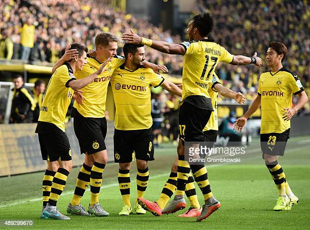 Jonas Hofmann of Borussia Dortmund celebrates with team mates as he scores the opening goal during the Bundesliga match between Borussia Dortmund and...