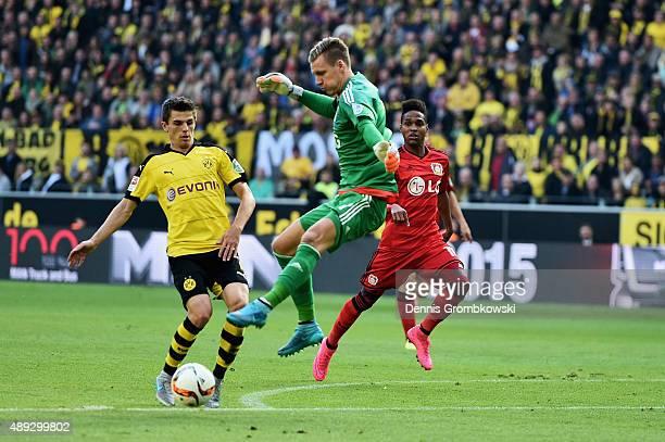 Jonas Hofmann of Borussia Dortmund plays the ball past goalkeeper Bernd Leno of Bayer Leverkusen during the Bundesliga match between Borussia...