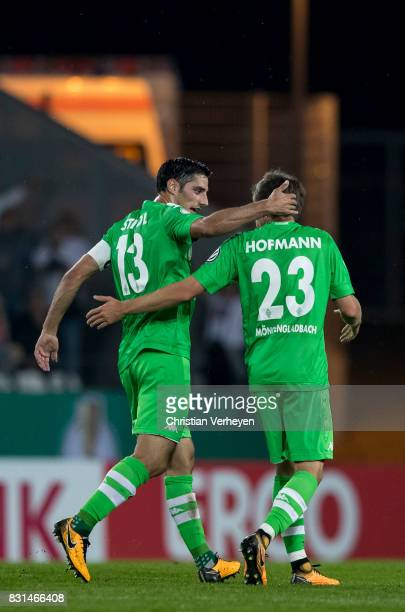 Jonas Hofmann of Borussia Moenchengladbach celebrate with team mate Lars Stindl after he scores his teams first goal during the DFB Cup match between...