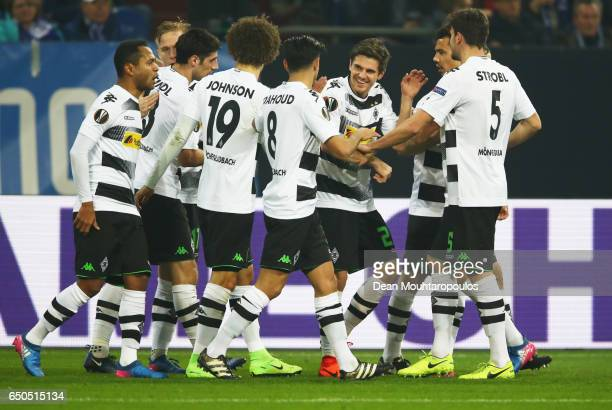 Jonas Hofmann of Borussia Moenchengladbach celebrates as he scores their first goal with team mates during the UEFA Europa League Round of 16 first...