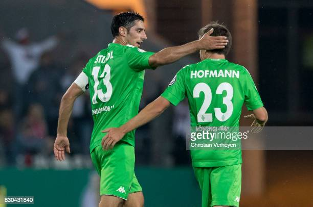 Jonas Hofmann of Borussia Moenchengladbach celebrates with team mate Lars Stindl after he scores his team's first goal during the DFB Cup match...