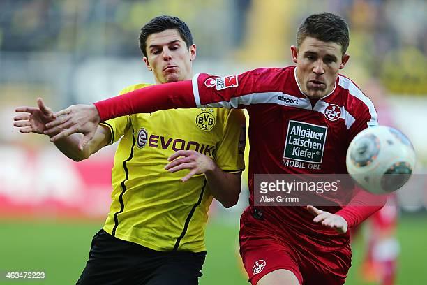 Jonas Hofmann of Dortmund is challenged by Dominguez Heintz of Kaiserslautern during the friendly match between 1 FC Kaiserslautern and Borussia...