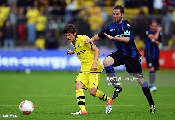 Jonas Hofmann of Dortmund is challenged by Michael Holt of Meppen during a friendly match between SV Meppen and Borussia Dortmund at MEPArena on July...