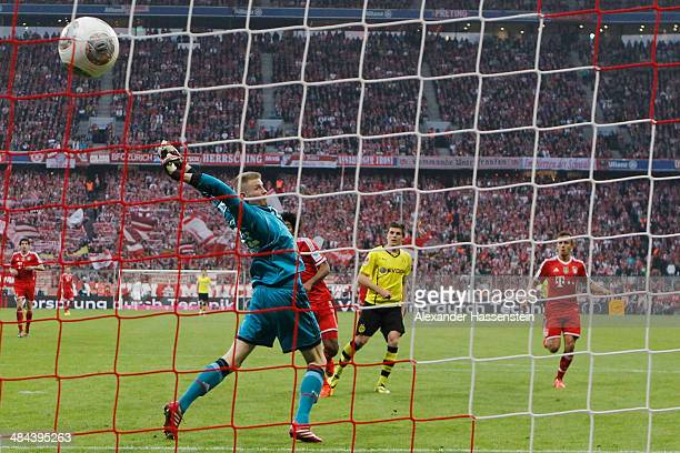Jonas Hofmann of Dortmund scores the 3rd team goal against Lukas Raeder keeper of Muenchen during the Bundesliga match between FC Bayern Muenchen and...