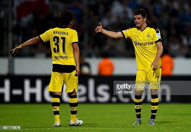 Jonas Hofmann of Dortmund speaks to team mate Mitsuru Maruoka during a preseason friendly match between VfL Bochum and Borussia Dortmund at...