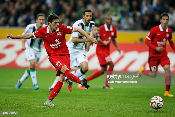 Jonas Hofmann of Mainz 05 takes and scores a penalty during the Bundesliga match between Borussia VfL 1900 Monchengladbach eVand 1 FSV Mainz 05...