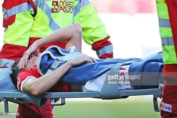 Jonas Hofmann of Mainz is carried off the pitch after suffering an injury during the Bundesliga match between 1 FSV Mainz 05 and FC Augsburg at...