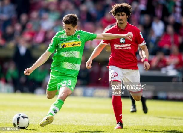 Jonas Hofmann of Moenchengladbach and Andre Ramalho of Mainz battle for the ball during the Bundesliga match between 1 FSV Mainz 05 and Borussia...