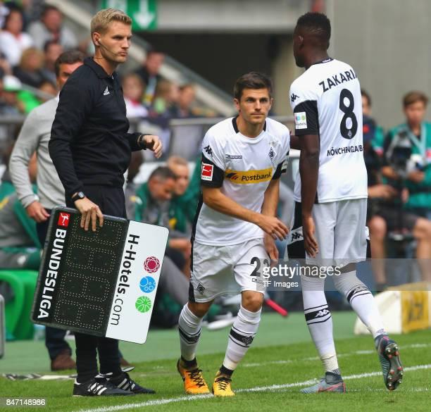 Jonas Hofmann of Moenchengladbach and Denis Zakaria of Moenchengladbach looks on during the Bundesliga match between Borussia Moenchengladbach and...
