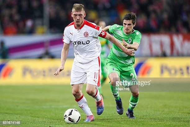 Jonas Hofmann of Moenchengladbach is challenged by Axel Bellinghausen of Duesseldorf during 3rd Place Match of Telekom Cup 2017 between Fortuna...