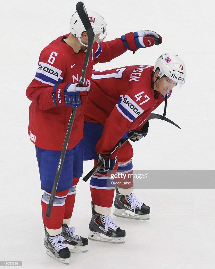 Jonas Holos and alexander Bonsaksen of Norway are disapointed after defeact during the 2014 IIHF World Championship between Slovakia and Norway at Chizhovka arena ,on may 14,2014 in Minsk, Belarus.