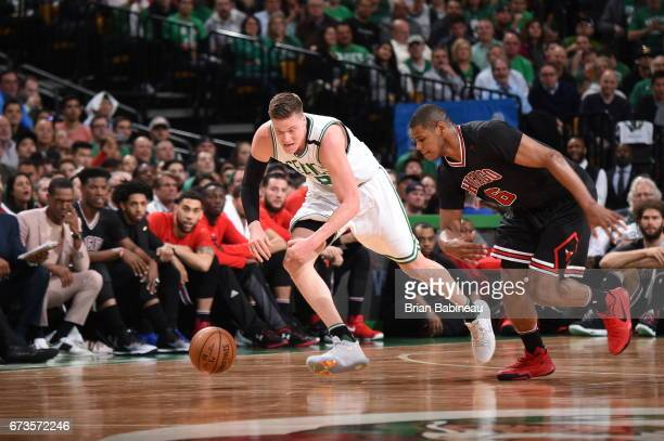 Jonas Jerebko of the Boston Celtics and Cristiano Felicio of the Chicago Bulls run for the ball during Game Five of the Eastern Conference...
