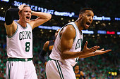 Jonas Jerebko of the Boston Celtics and Evan Turner react after a foul was called against Turner during the fourth quarter of Game Three of the...