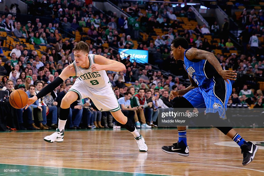 Jonas Jerebko of the Boston Celtics and Keith Appling of the Orlando Magic battle for a loose ball during the fourth quarter at TD Garden on January...