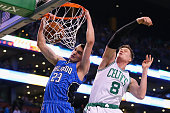 Jonas Jerebko of the Boston Celtics defends a shot by Mario Hezonja of the Orlando Magic during the second quarter at TD Garden on January 29 2016 in...