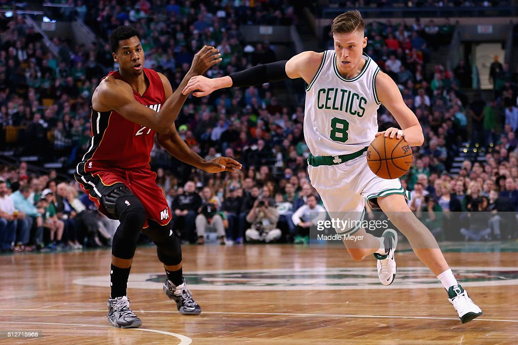Jonas Jerebko of the Boston Celtics drives against Hassan Whiteside of the Miami Heat during the fourth quarter at TD Garden on February 27 2016 in...