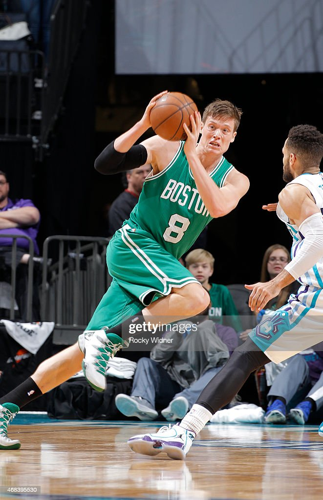 Jonas Jerebko of the Boston Celtics drives against the Charlotte Hornets on March 30 2015 at Time Warner Cable Arena in Charlotte North Carolina NOTE...