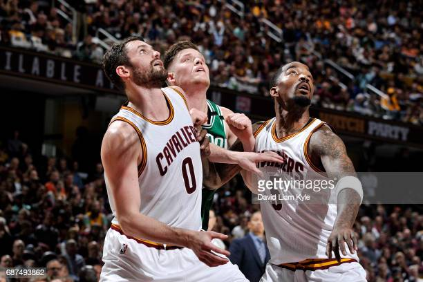 Jonas Jerebko of the Boston Celtics fights for the position against Kevin Love and JR Smith of the Cleveland Cavaliers in Game Four of the Eastern...