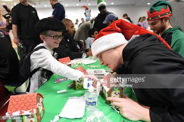 Jonas Jerebko of the Boston Celtics spreads holiday cheer duing a children's hospital visit on December 1 2016 at Boston Children's Hospital in...