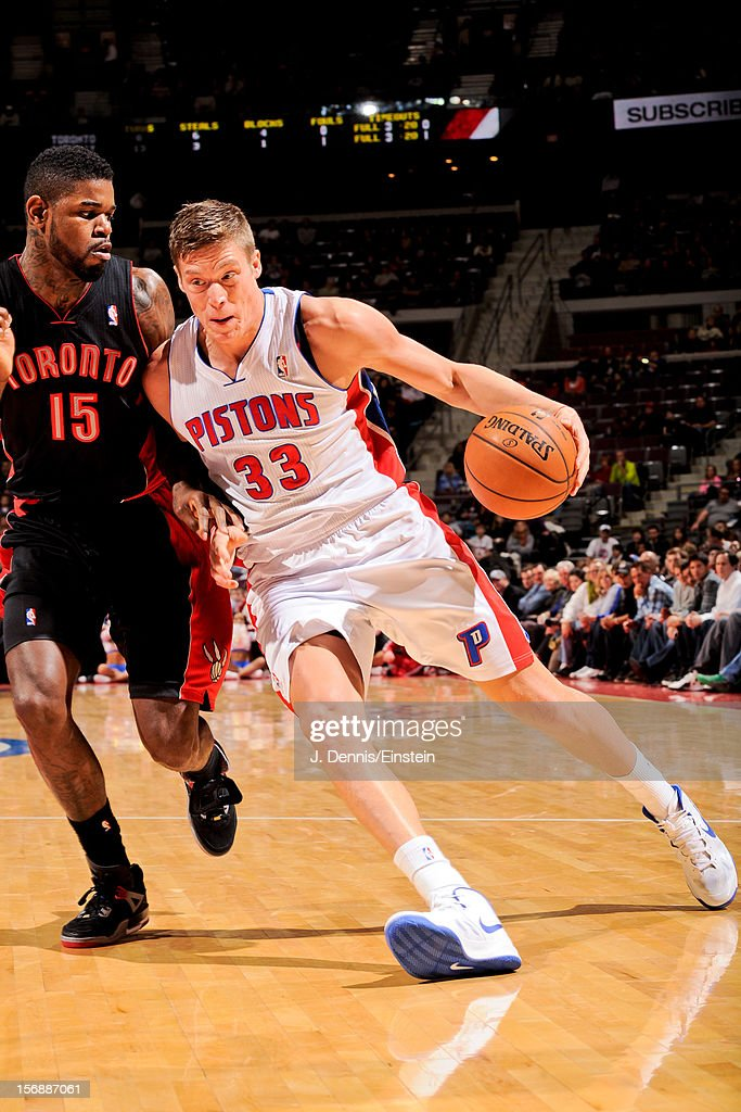 Jonas Jerebko #33 of the Detroit Pistons drives against Amir Johnson #15 of the Toronto Raptors on November 23, 2012 at The Palace of Auburn Hills in Auburn Hills, Michigan.
