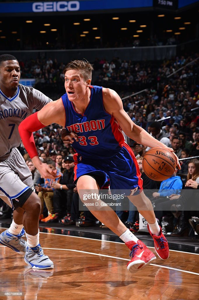 Jonas Jerebko of the Detroit Pistons drives baseline against the Brooklyn Nets on December 21 2014 at the Barclays Center in Brooklyn NY NOTE TO USER...