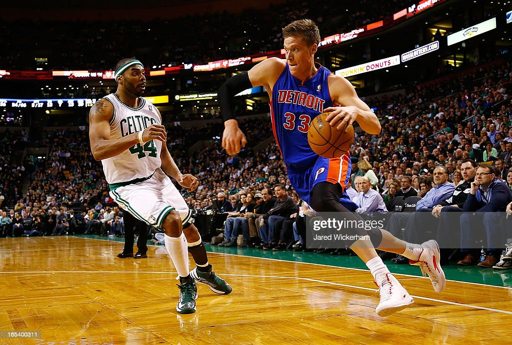 Jonas Jerebko of the Detroit Pistons drives to the basket against Chris Wilcox of the Boston Celtics during the game on April 3 2013 at TD Garden in...