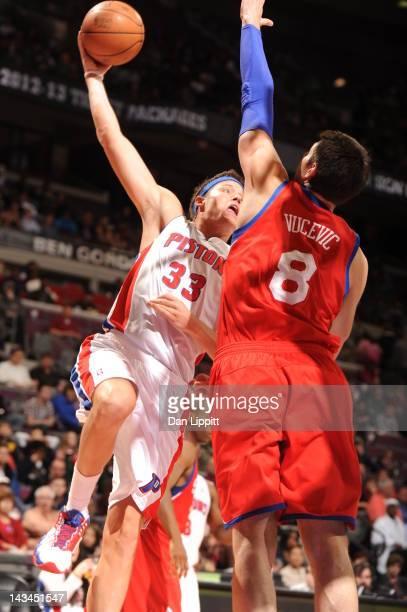 Jonas Jerebko of the Detroit Pistons goes against Nikola Vucevic of the Philadelphia 76ers during the game between the Detroit Pistons and the...