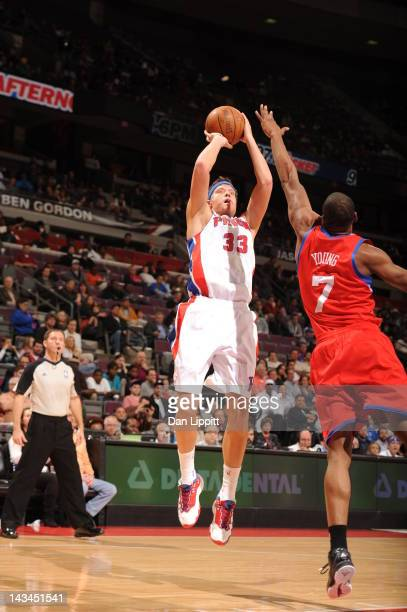Jonas Jerebko of the Detroit Pistons goes for a jump shot against Sam Young of the Philadelphia 76ers during the game between the Detroit Pistons and...