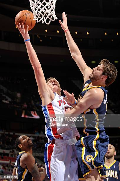 Jonas Jerebko of the Detroit Pistons goes to the basket against Josh McRoberts of the Indiana Pacers during the game on January 22 2010 at The Palace...