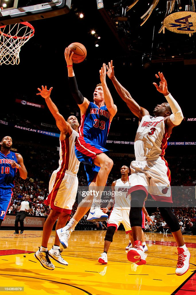 <a gi-track='captionPersonalityLinkClicked' href=/galleries/search?phrase=Jonas+Jerebko&family=editorial&specificpeople=5942357 ng-click='$event.stopPropagation()'>Jonas Jerebko</a> #33 of the Detroit Pistons goes to the basket against <a gi-track='captionPersonalityLinkClicked' href=/galleries/search?phrase=Shane+Battier&family=editorial&specificpeople=201814 ng-click='$event.stopPropagation()'>Shane Battier</a> #31 and <a gi-track='captionPersonalityLinkClicked' href=/galleries/search?phrase=Dwyane+Wade&family=editorial&specificpeople=201481 ng-click='$event.stopPropagation()'>Dwyane Wade</a> #3 of the Miami Heat during a pre-season game on October 18, 2012 at American Airlines Arena in Miami, Florida.