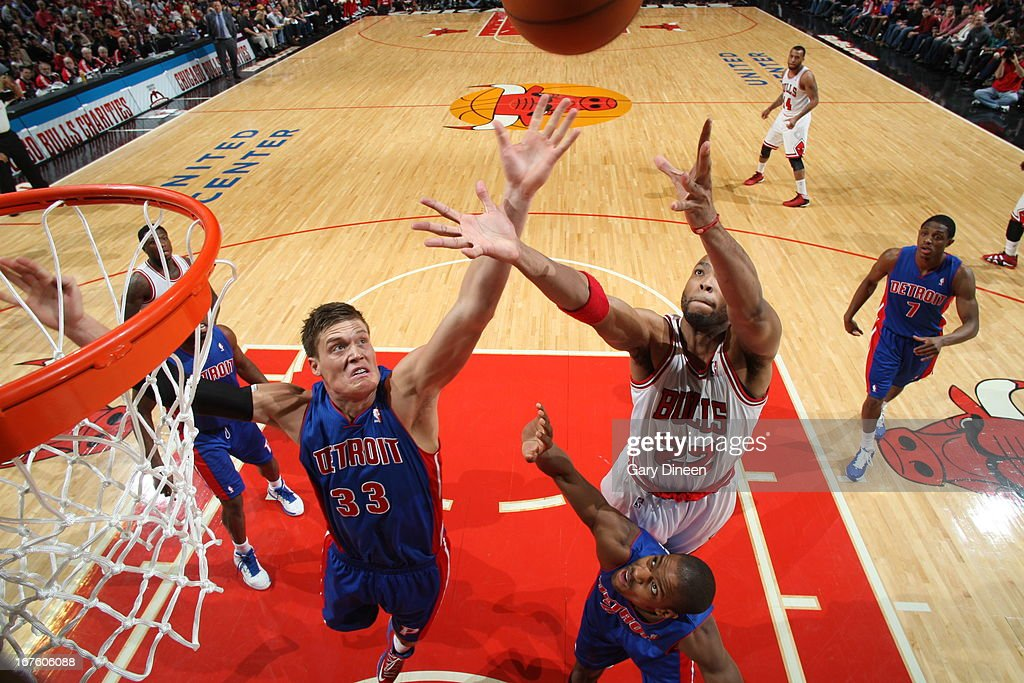 Jonas Jerebko #33 of the Detroit Pistons goes up for a rebound against Taj Gibson #22 of the Chicago Bulls on March 31, 2013 at the United Center in Chicago, Illinois.