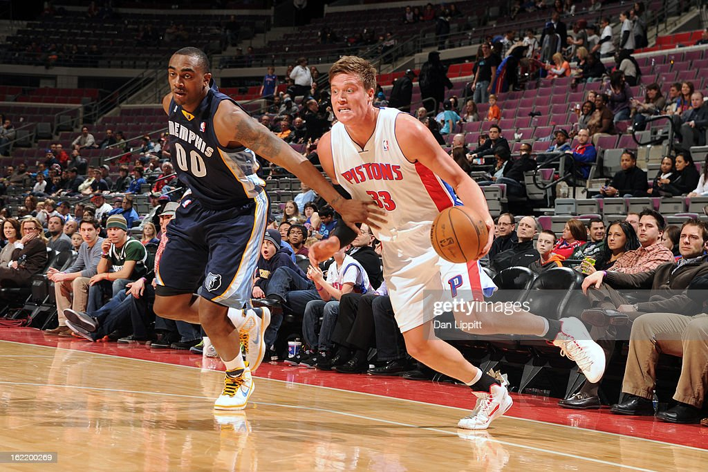 Jonas Jerebko #33 of the Detroit Pistons handles the ball against Darrell Arthur #00 of the Memphis Grizzlies on February 19, 2013 at The Palace of Auburn Hills in Auburn Hills, Michigan.