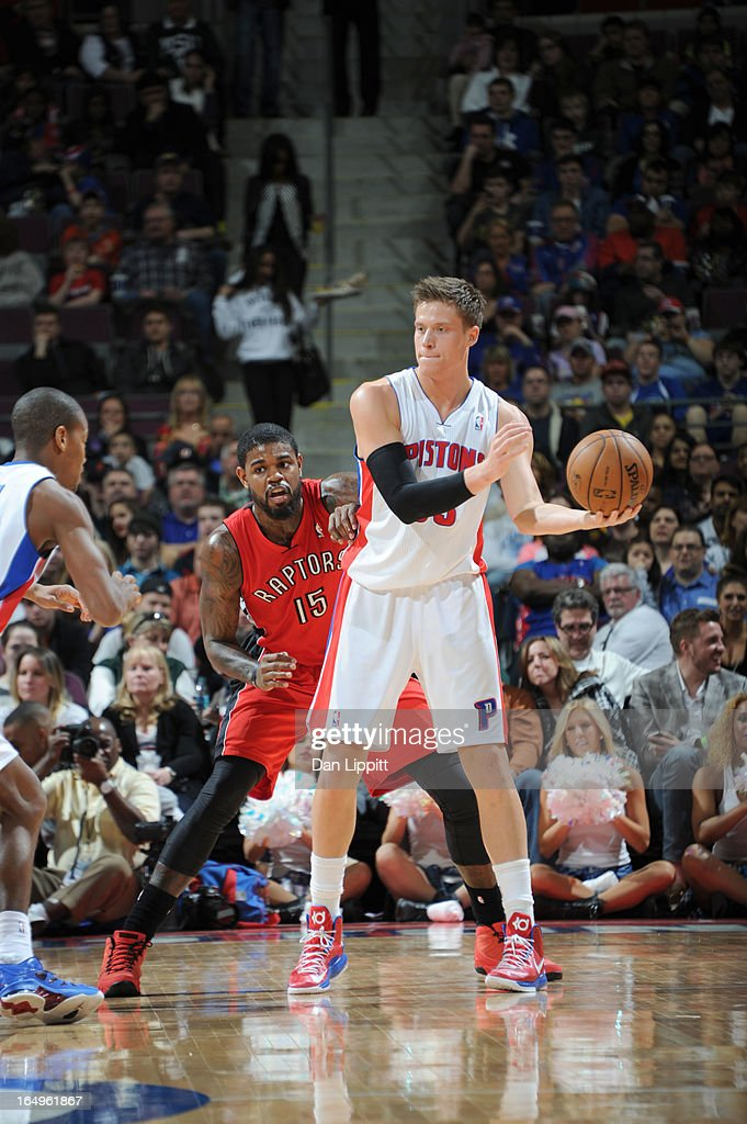 Jonas Jerebko #33 of the Detroit Pistons protects the ball from Amir Johnson #15 of the Toronto Raptors during the game between the Detroit Pistons and the Toronto Raptors on March 29, 2013 at The Palace of Auburn Hills in Auburn Hills, Michigan.