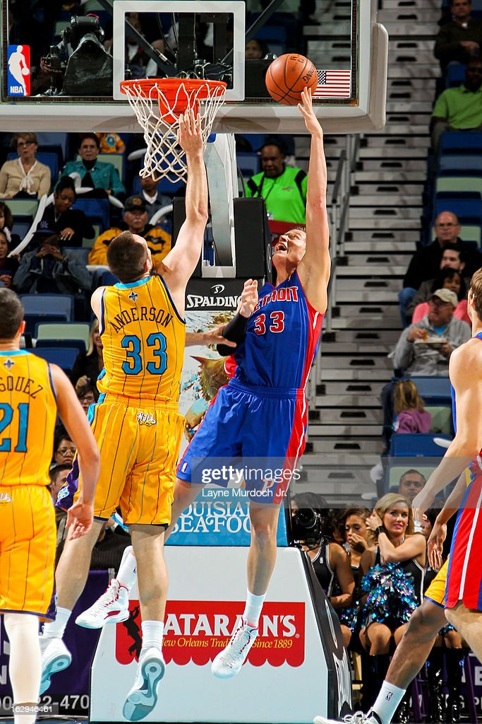 Jonas Jerebko #33 of the Detroit Pistons shoots a reverse layup against Ryan Anderson #33 of the New Orleans Hornets on March 1, 2013 at the New Orleans Arena in New Orleans, Louisiana.