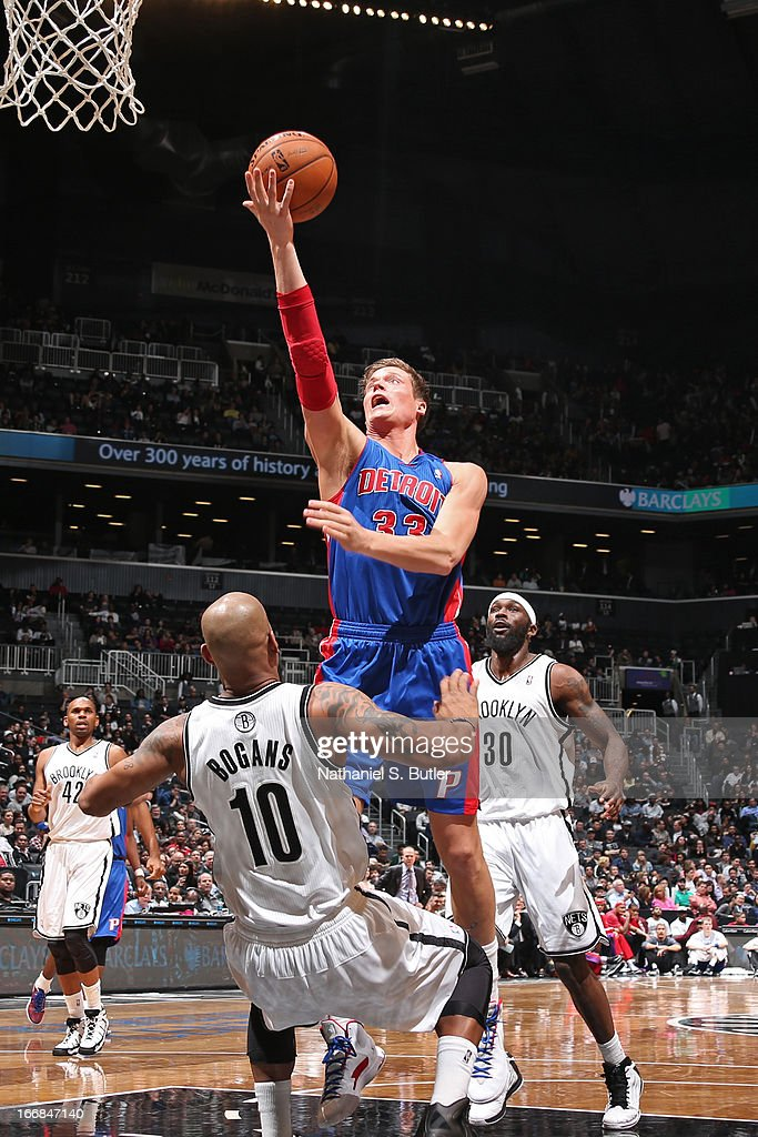 Jonas Jerebko #33 of the Detroit Pistons shoots against Keith Bogans #10 of the Brooklyn Nets on April 17, 2013 at the Barclays Center in the Brooklyn borough of New York City.