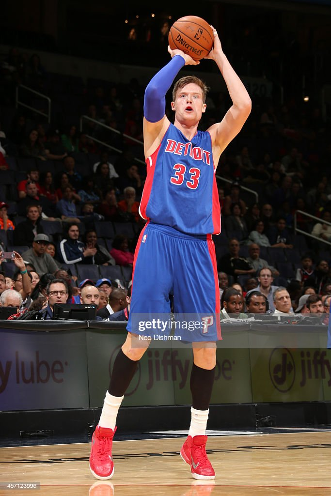 Jonas Jerebko of the Detroit Pistons shoots against the Washington Wizards during the game on October 12 2014 at Verizon Center in Washington...
