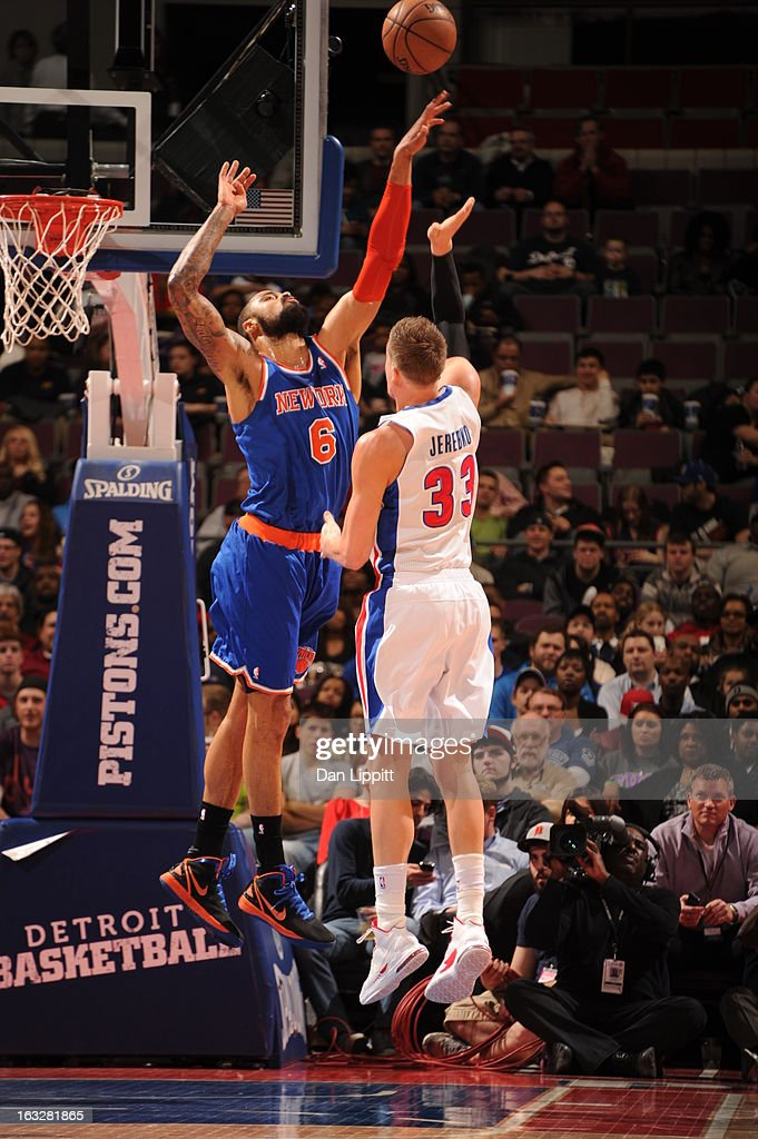 Jonas Jerebko #33 of the Detroit Pistons shoots the ball against Tyson Chandler #6 of the New York Knicks during the game between the Detroit Pistons and the Atlanta Hawks on March 6, 2013 at The Palace of Auburn Hills in Auburn Hills, Michigan.