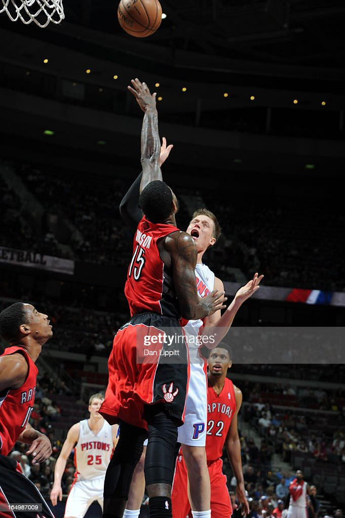 Jonas Jerebko #33 of the Detroit Pistons shoots the ball over Amir Johnson #15 of the Toronto Raptors during the game between the Detroit Pistons and the Toronto Raptors on March 29, 2013 at The Palace of Auburn Hills in Auburn Hills, Michigan.