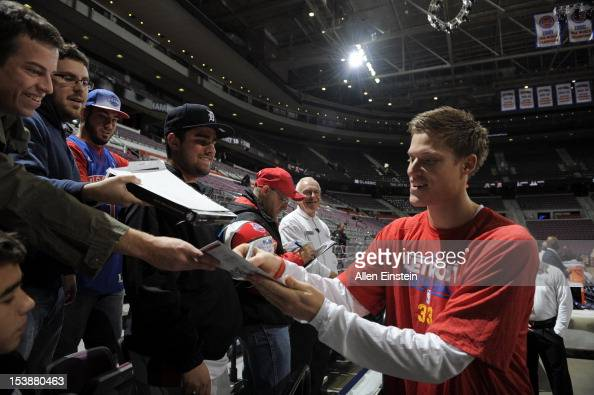 Jonas Jerebko of the Detroit Pistons signs autographs during the game between the Detroit Pistons of the Toronto Raptors on October 10 2012 at The...