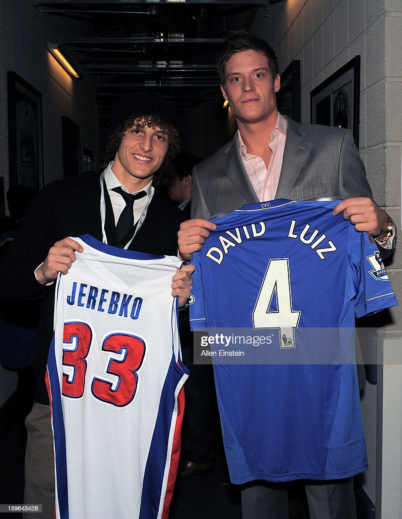 Jonas Jerebko #33 of the Detroit pistons swaps jerseys with David Luiz #4, professional footballer from Chelsea of the Premier League after the game at the 02 Arena on January 17, 2013 in London, England.