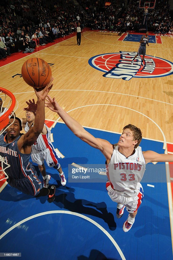 Jonas Jerebko #33 of the Detroit Pistons tries to stop Derrick Brown #4 of the Charlotte Bobcats from reaching the basket during the game on March 31, 2012 at The Palace of Auburn Hills in Auburn Hills, Michigan.