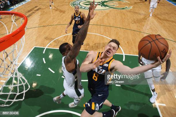 Jonas Jerebko of the Utah Jazz goes to the basket against the Milwaukee Bucks on December 9 2017 at the BMO Harris Bradley Center in Milwaukee...