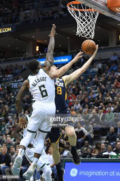 Jonas Jerebko of the Utah Jazz is defended by Eric Bledsoe of the Milwaukee Bucks during a game at the Bradley Center on December 9 2017 in Milwaukee...