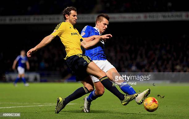 Jonas Knudsen of Ipswich Town and Christian Stuani of Middlesbrough compete for the ball during the Sky Bet Championship match between Ipswich Town...