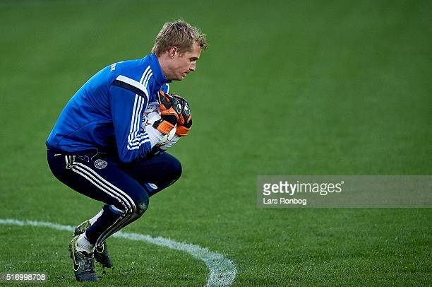 Jonas Lossl dives to save the ball during the Denmark training session at MCH Arena on March 22 2016 in Herning Denmark