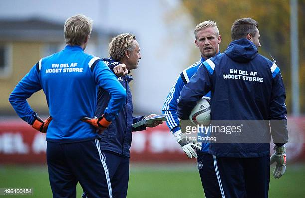 Jonas Lossl Lars Hoegh goalkeeper coach Kasper Schmeichel and Stephan Andersen speaks to eachother during the Denmark Training Session at Helsingor...